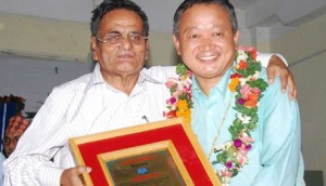Prof. Bal Krishna Pokhrel felicitating Nawa Raj Subba.
